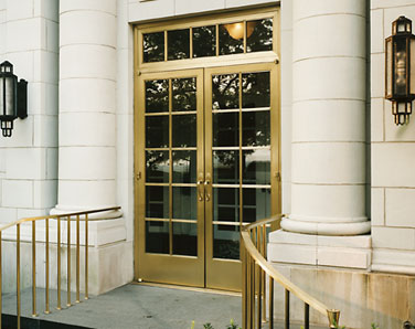Satin bronze alloy exterior door, transom and hand rails