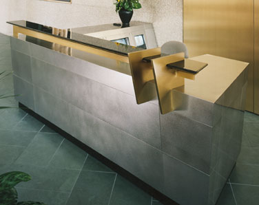 stainless steel and bronze alloy reception desk with satin finish