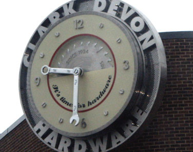 Brushed stainless steel exterior clock display for hardware retailer